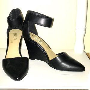 Black wedge heels.
